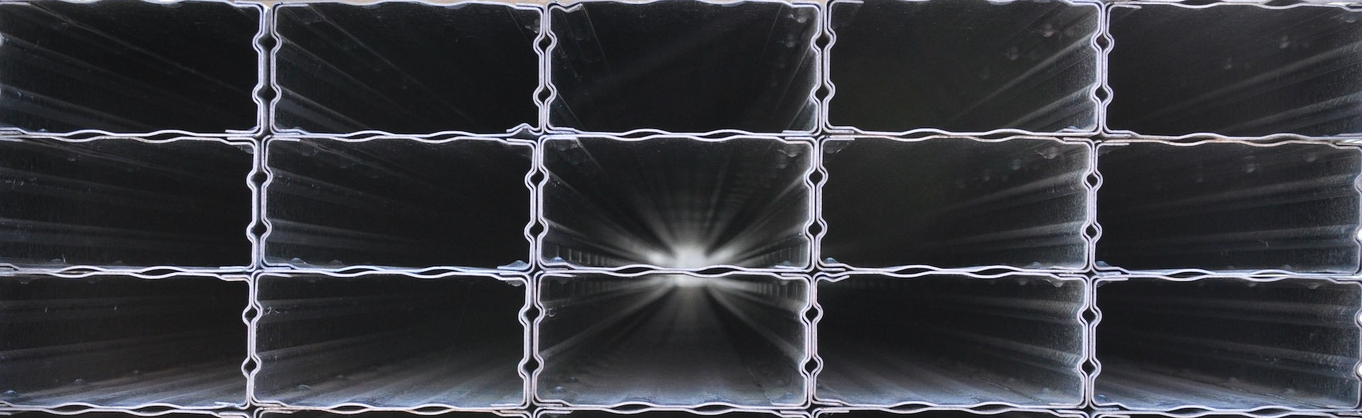 End view of a stack of Boxspan steeljoist beams B100-12 B150-12 B150-16 B200-16 B200-20 B250-20