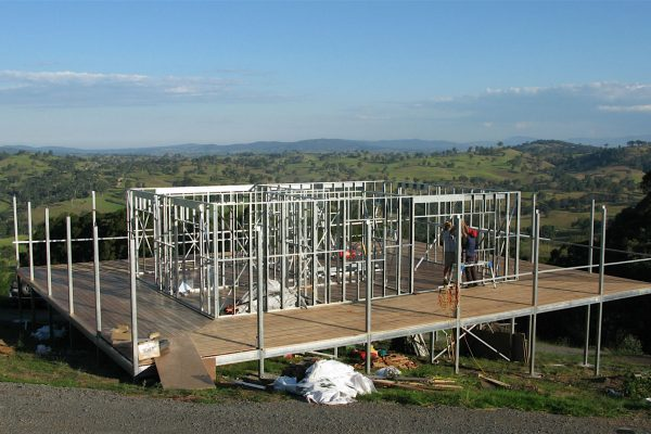 Highset Boxspan floor frame with wrap around verandah on sloping site
