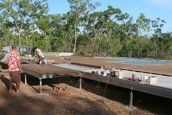Boxspan floor frame on Ezipier with timber decking and floor sheet installation underway