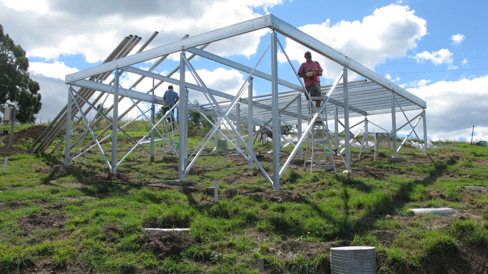 On a steeply sloped block of land owner builder Bill commences construction of a Boxspan floor frame with Ezipiers and cross-bracing.