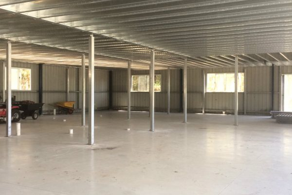 Boxspan mezzanine floor frame providing storage space in a shed