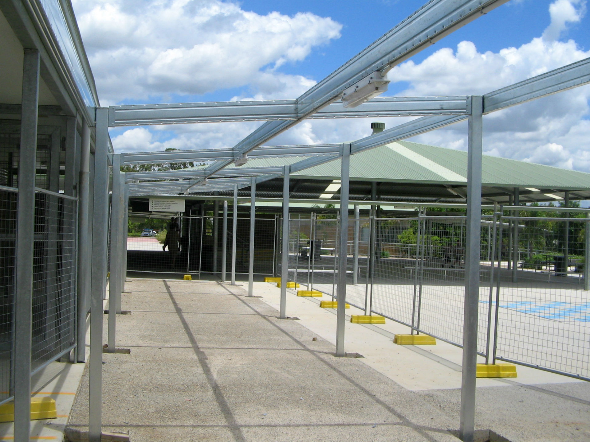 Boxspan covered walkway and awning frames in commercial site