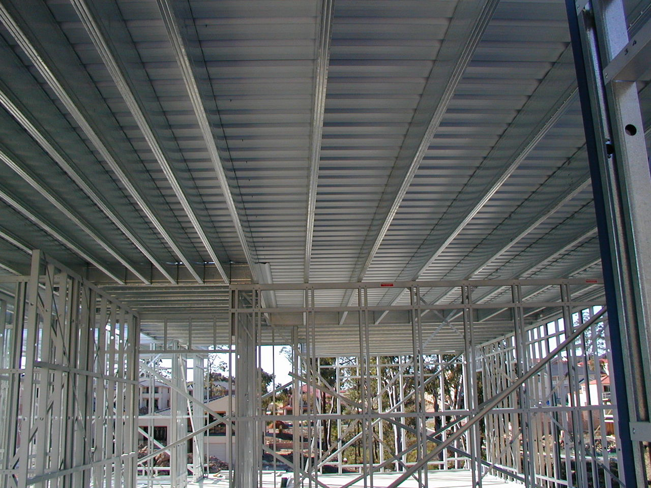 Boxspan upper floor frame on steel wall frames supporting smart slab liteslab first floor
