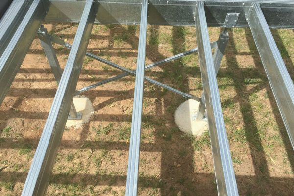 looking down on a Boxspan residential floor framing system with steel piles and crossbracing
