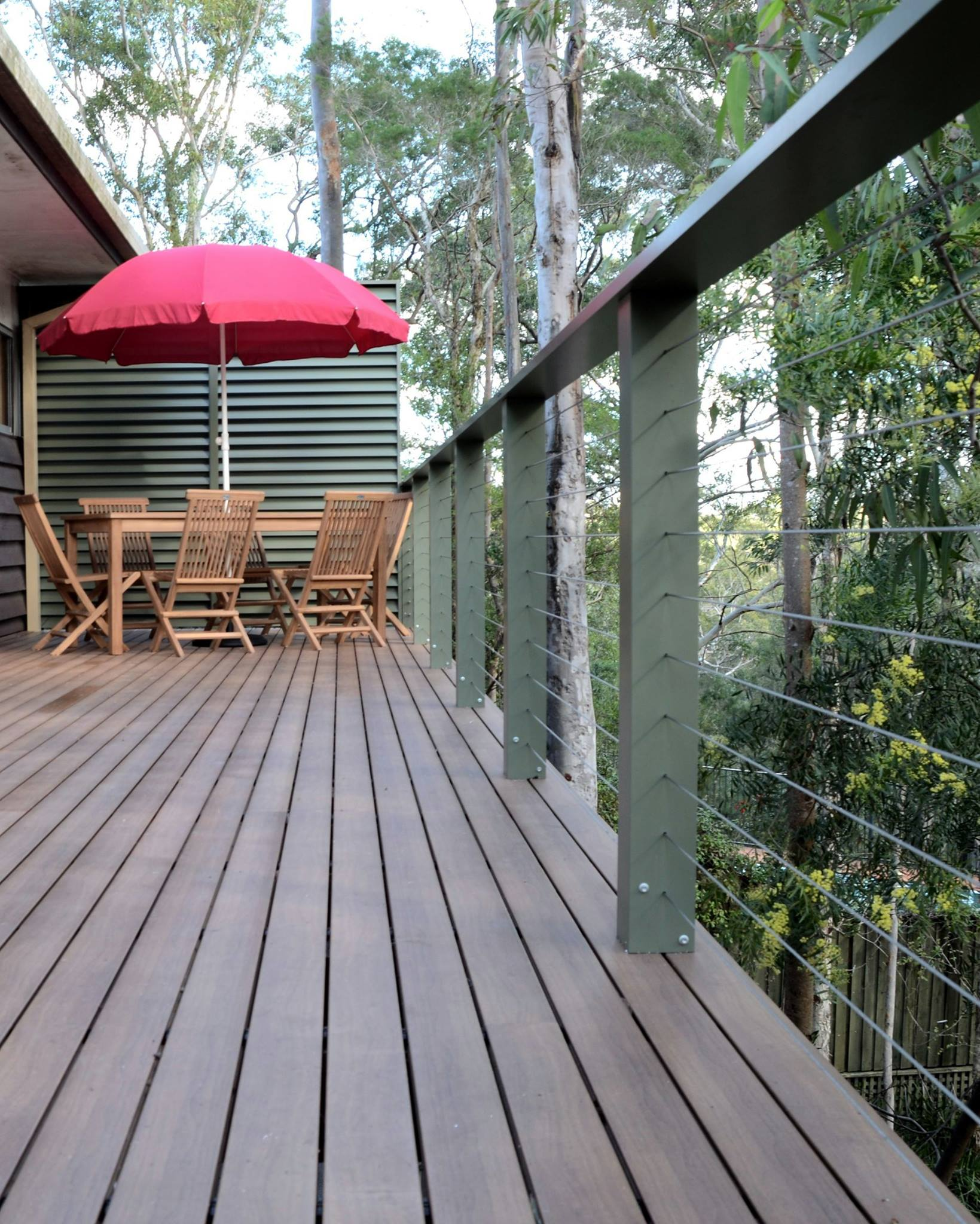 Boxspan deck frame and aluminium decking boards coated to appear like timber in a bushfire flame zone