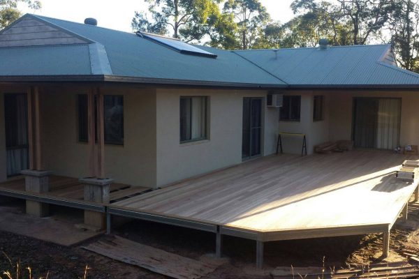 Decking boards down on Boxspan steel bearers and joists to increase outdoor living space for this existing house