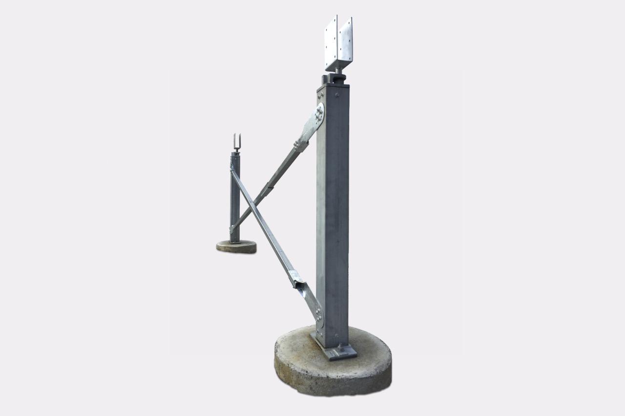 Ezibrace cross bracing and Ezipier Adjustable pier heads above the SHS posts, and Ezipier bases on concrete footings.