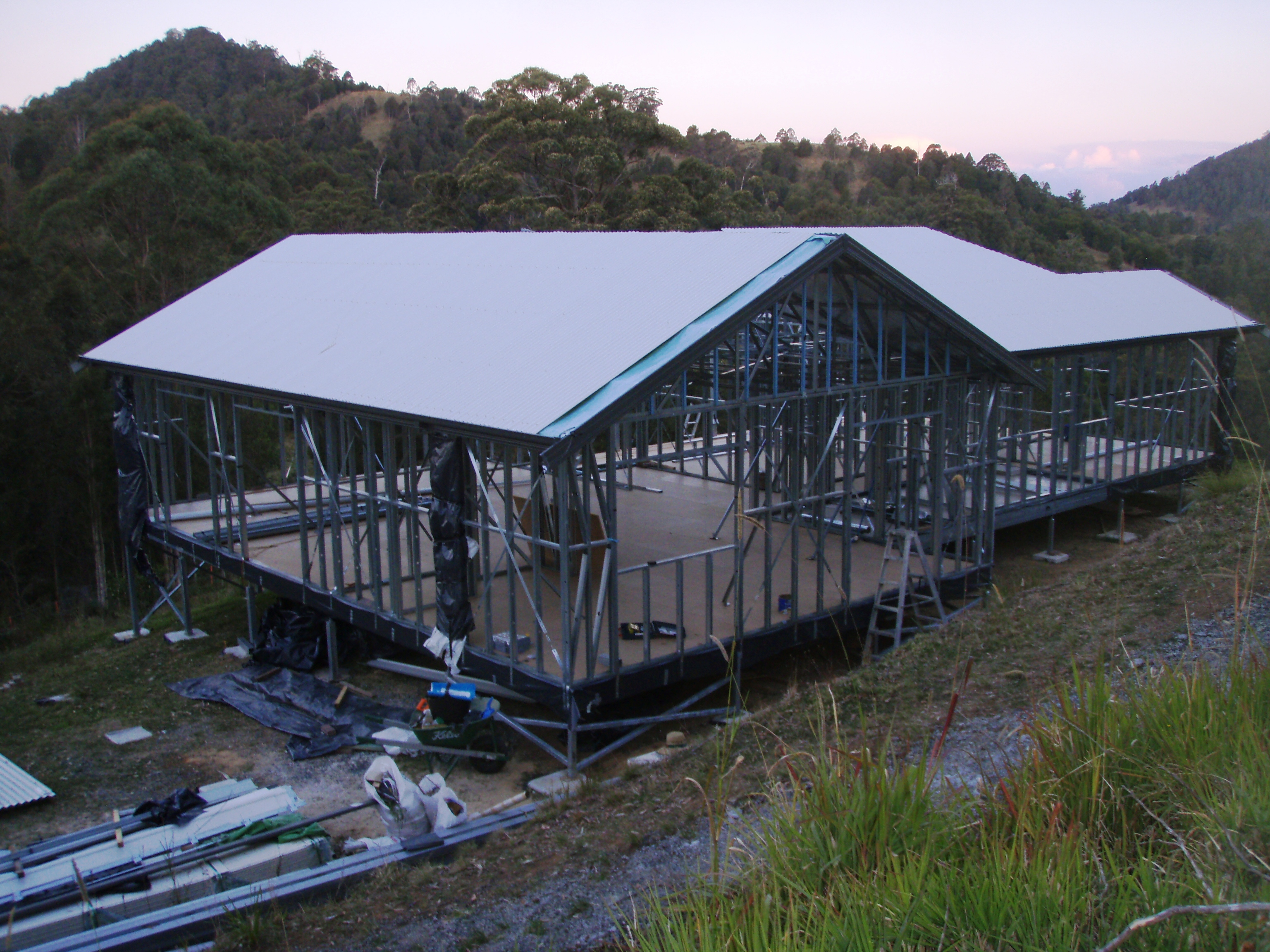 Boxspan floor frame and Ezipier on sloping site