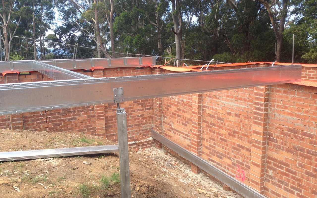 Ezipier supporting Boxspan elevated floor frame within enclosed brick walling