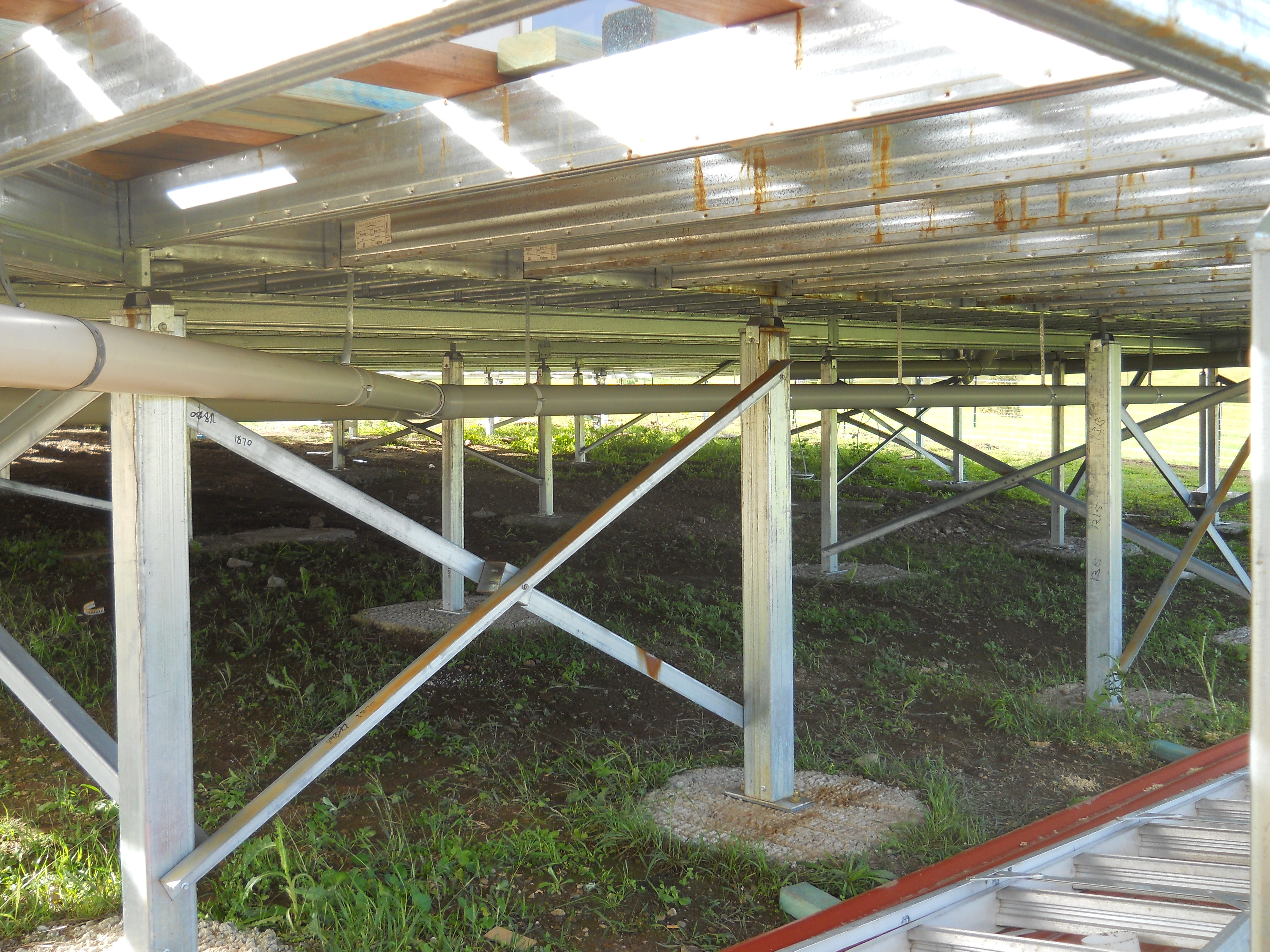 looking underneath the floor at the steel floor frame supported by