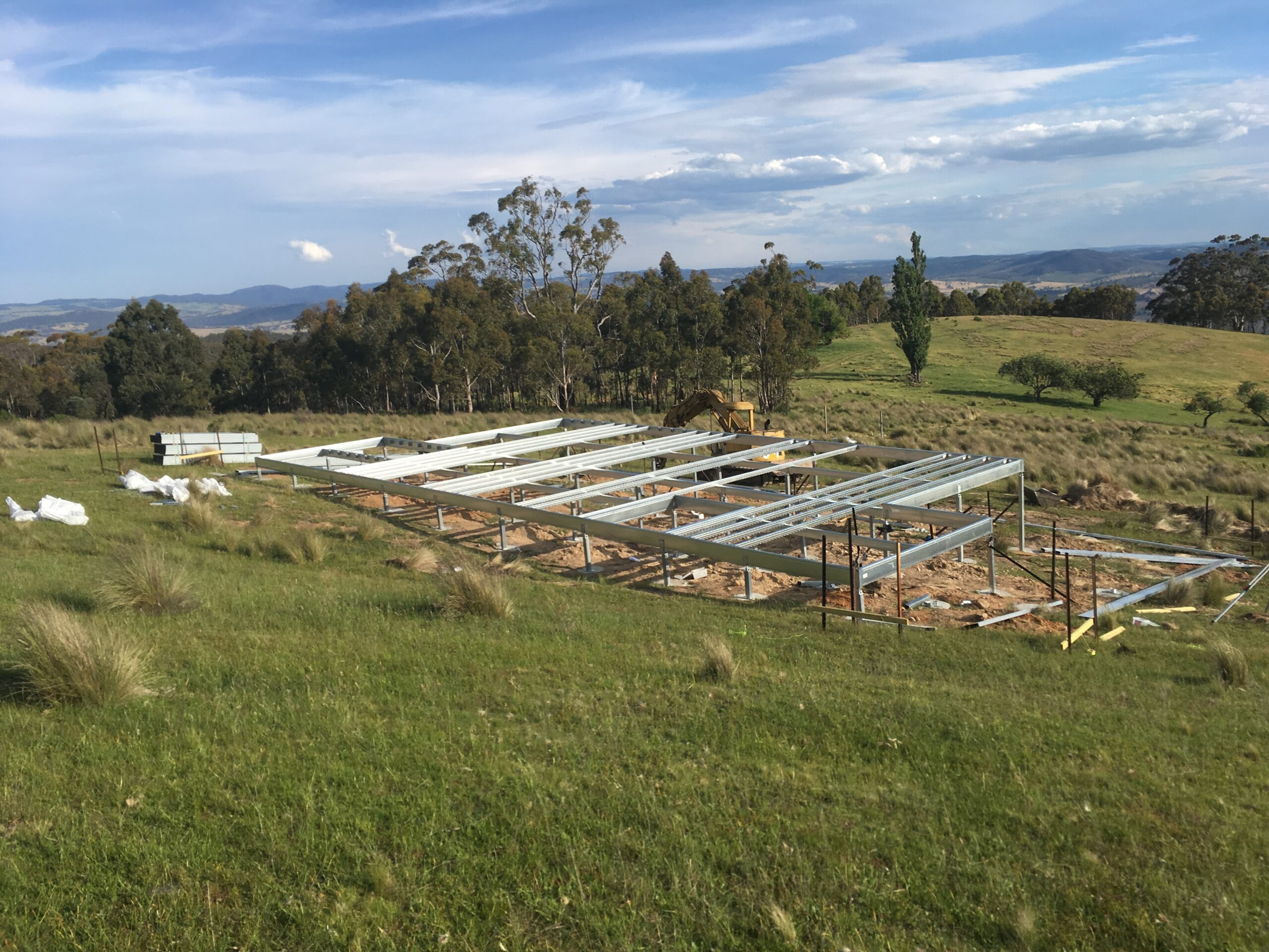 Boxspan floor frame construction by owner builder underway on a sloping site