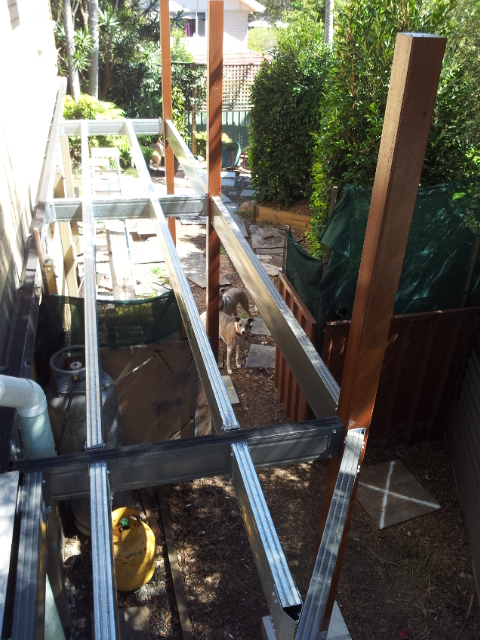 Boxspan covered walkway frame alone side of house bearers attaching to house and posts with brackets
