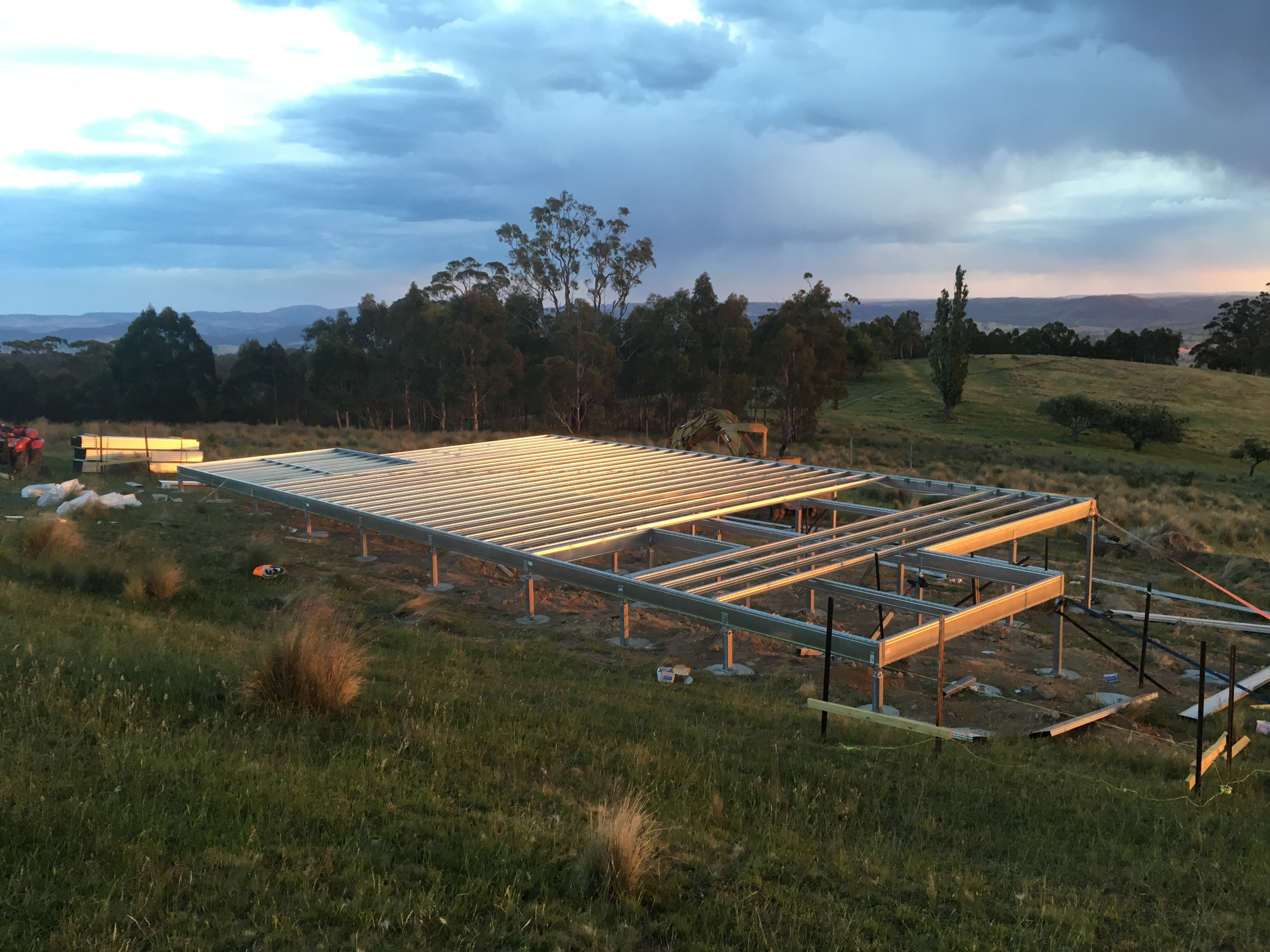 Boxspan floor frame nearing completion by owner builder on a sloping site
