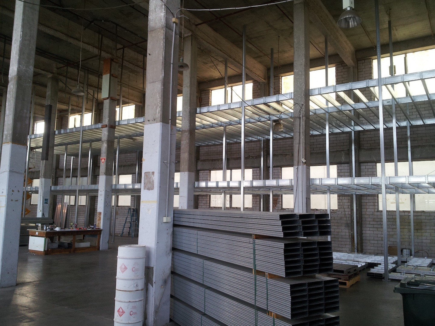 Installing of Boxspan mezzanine floor frames in a factory for storage lockers.