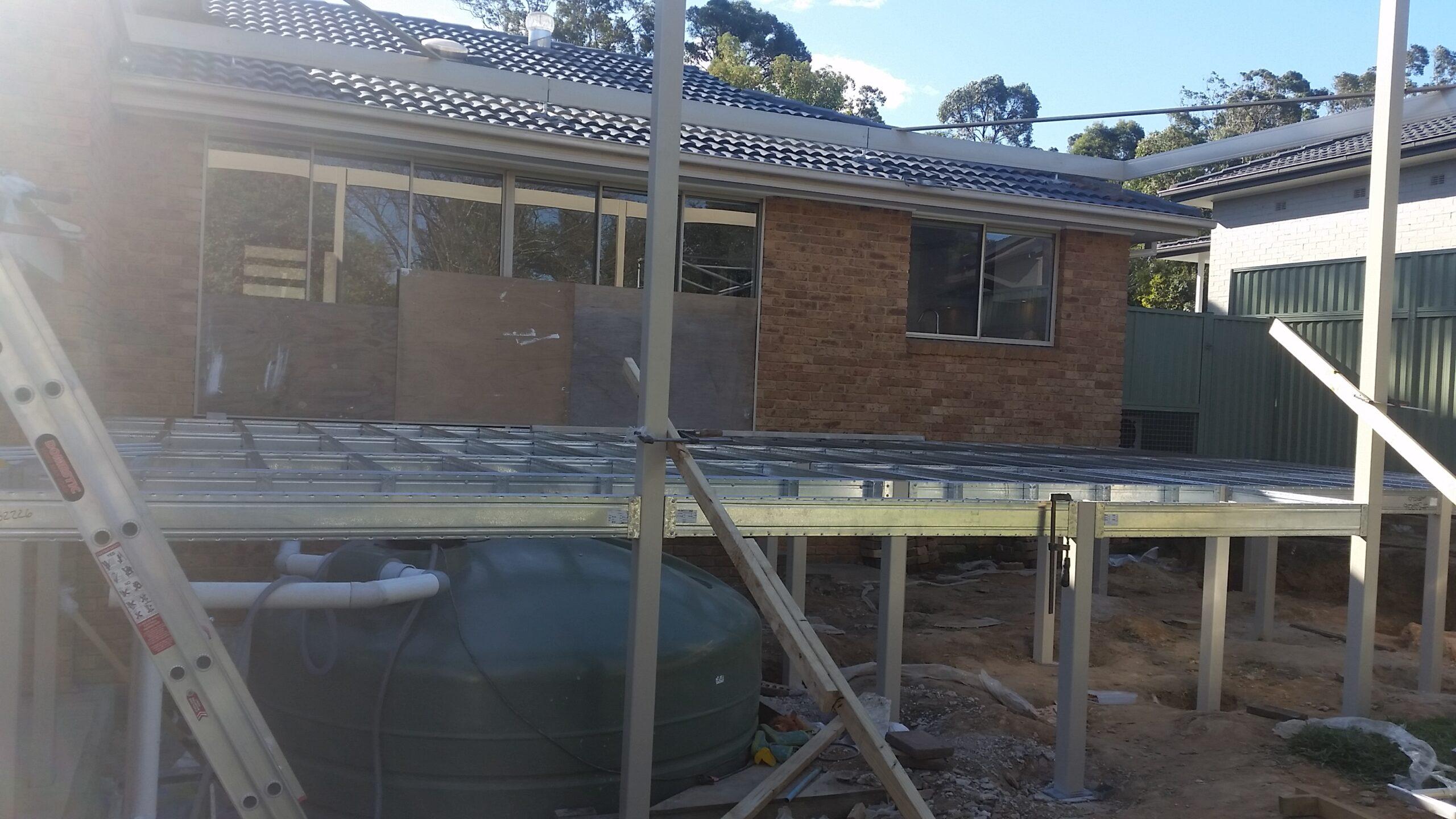 Boxspan deck frame built over a rainwater tank
