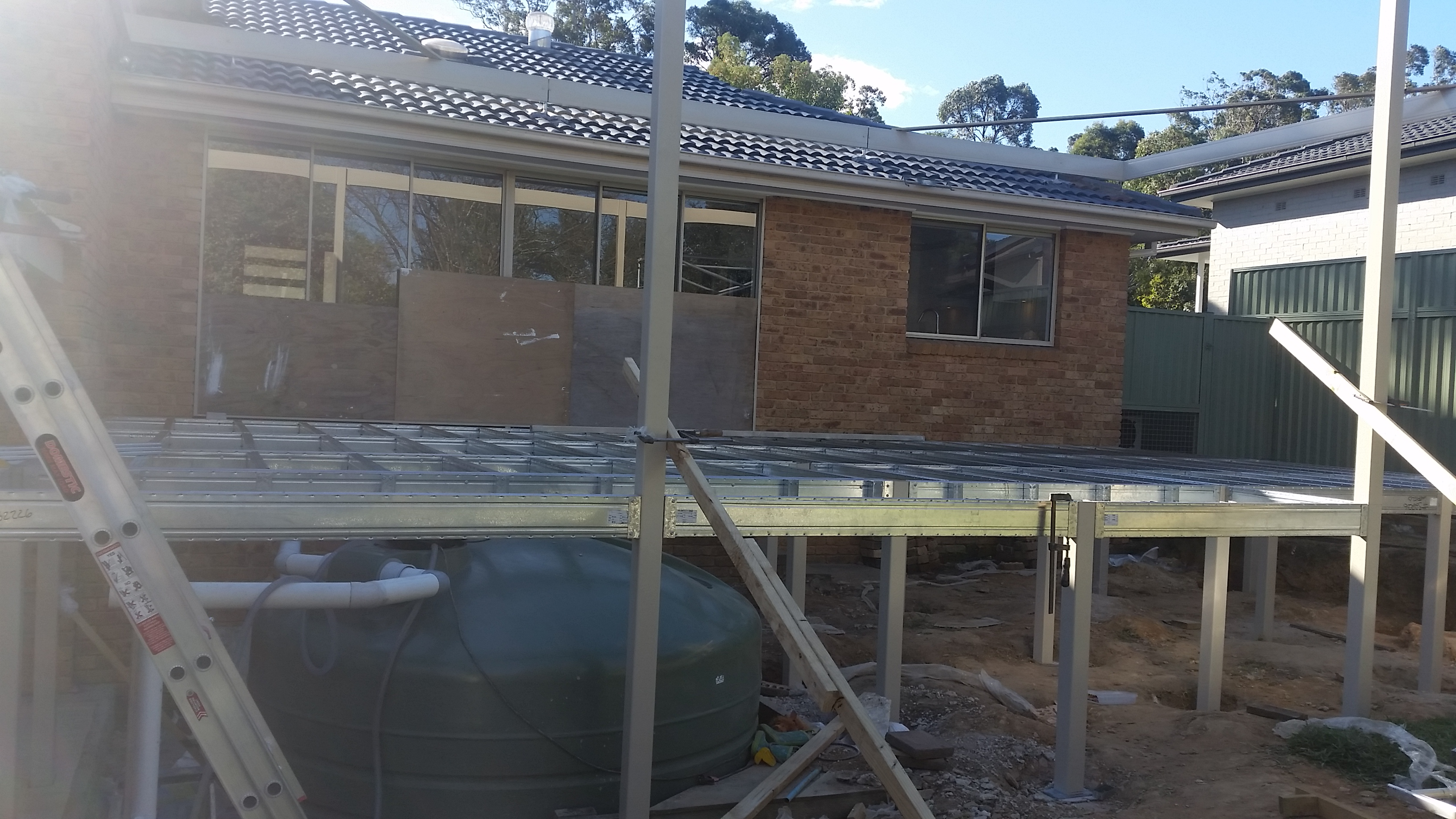 Boxspan deck frame built over a rainwater tank
